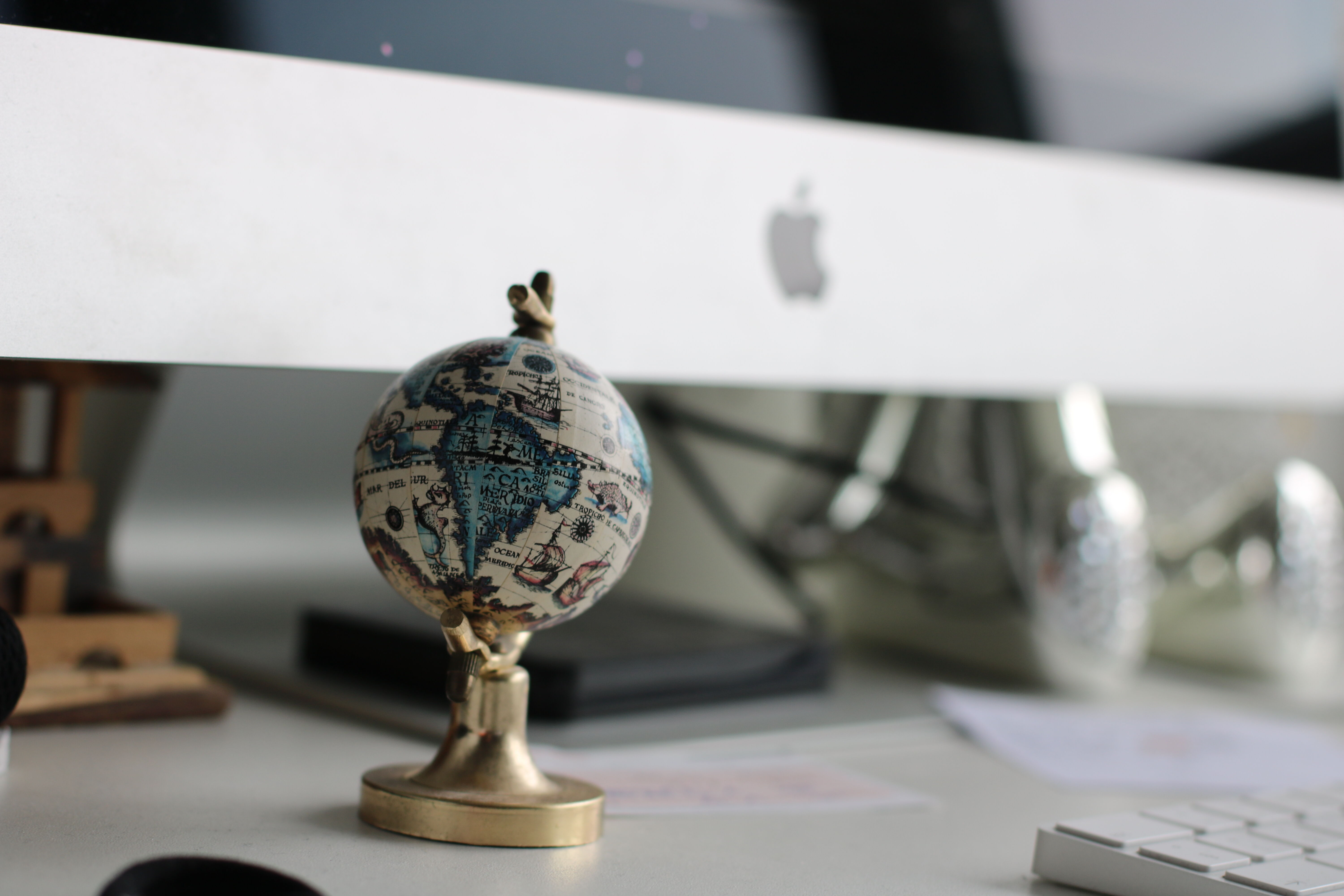 globe on top of white wooden table